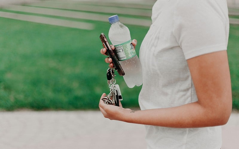 person with bottled water